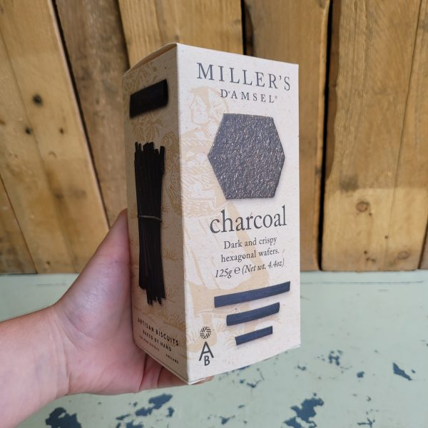 A box of charcoal black hexagonal crackers.